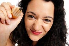 Junge Frau mit der großen Bleistiftbetragkamera getrennt Stockfoto