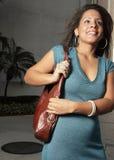 Junge Frau mit einem Fonds Lizenzfreies Stockbild