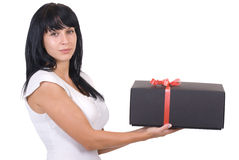 Junge Frau mit einem Geschenk Lizenzfreies Stockfoto