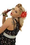 Junge Frau mit einem Retro- Telefon lizenzfreie stockfotos