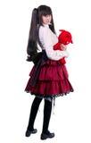 Junge Frau mit einem roten Spielzeug Stockfoto