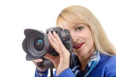 Junge Frau mit einer Kamera an auf Weiß Stockfotos