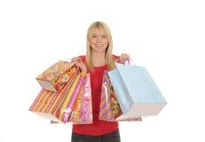 Junge Frau mit Einkaufenbeuteln Stockbilder