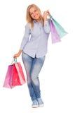 Junge Frau mit Einkaufenbeuteln Lizenzfreies Stockfoto