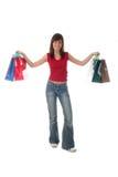 Junge Frau mit Einkaufenbeuteln Stockbild