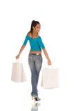 Junge Frau mit Einkaufenbeuteln Lizenzfreie Stockfotos