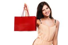 Junge Frau mit Einkaufstaschen stockfotografie