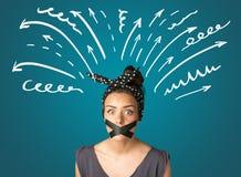 Junge Frau mit geklebtem Mund Stockfoto
