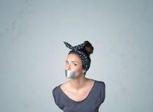 Junge Frau mit geklebtem Mund Stockbilder