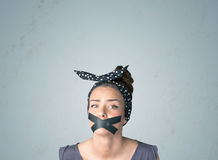 Junge Frau mit geklebtem Mund Stockbild