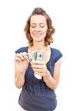 Junge Frau mit Geld in den Händen Lizenzfreies Stockbild