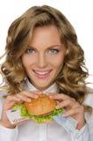 Junge Frau mit Hamburger vom Euro Stockfotos