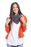 Junge Frau mit ihren Fingern gekreuzt stockfotografie