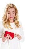 Junge Frau mit leerer Tasche, auf Weiß Stockbild