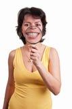 Junge Frau mit Lupe an ihrem Mund - Zeigen von Zähnen Lizenzfreies Stockbild