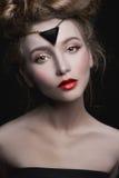 Junge Frau mit Make-up Stockfotografie