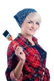 Junge Frau mit Malerpinsel Stockbild