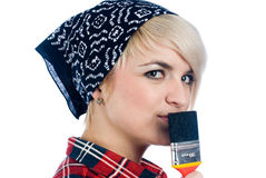 Junge Frau mit Malerpinsel Stockbilder