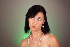 Junge Frau mit neugierigem Ausdruck Stockfotos