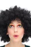Junge Frau mit oben Afroschauen Stockfoto