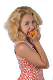 Junge Frau mit Orange Stockfotografie