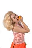Junge Frau mit Orange Stockfotos