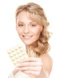 Junge Frau mit Pillen Stockbilder