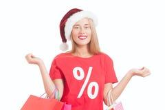 junge Frau mit Sankt-Hut und -Einkaufstaschen Lizenzfreie Stockbilder