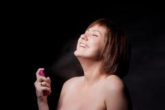 Junge Frau mit Spray Stockfotos