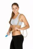 Junge Frau mit Sprung-Seil über Schulter Stockfoto