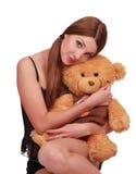 Junge Frau mit Teddybär-tragen Lizenzfreies Stockbild