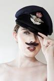 Junge Frau mit tragender Schutzkappe des Schnurrbartes Lizenzfreies Stockbild