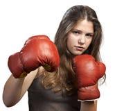 Junge Frau mit Verpackenhandschuhen Stockbild