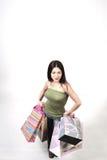 Junge Frau mit vielen Beuteln Stockbilder