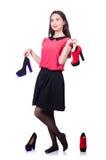 Junge Frau mit Wahl von Schuhen Lizenzfreie Stockfotos