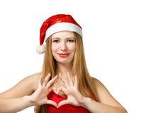 Junge Frau in Sankt-Hut mit Herzform Stockbild