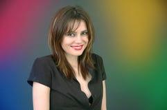 Junge Frau umgeben durch Farbe. Stockbild
