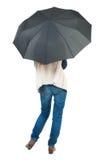 Junge Frau unter einem Regenschirm Stockbilder