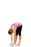 Junge Frau in verbogener Yogahaltung Stockfoto