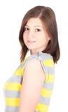 Junge Frau, welche die Eignungsübungen getrennt auf weißem Hintergrund tut Lizenzfreie Stockbilder