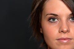Junge Frauen-Gesichts-Schuß Stockfoto