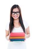 Junge Frauen-Holding-Bücher Lizenzfreies Stockfoto