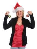 Junge Frauen-Holding-Weihnachtsverzierungen lizenzfreies stockfoto