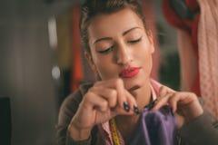 Junge Frauen-Schneider Stockfotos