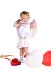Junge gekleidet als Engel mit den weißen und roten Ballonen stockfoto
