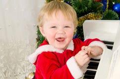 Junge gekleidet als Weihnachtsmann lizenzfreies stockbild