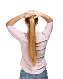 Junge Geschäftsfrau auf weißer Hintergrundrückseitenansicht Stockbilder