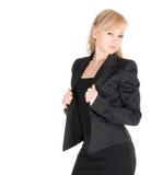 Junge Geschäftsfrau, die über weißem Hintergrund aufwirft Stockfotografie