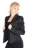 Junge Geschäftsfrau, die über weißem Hintergrund aufwirft Lizenzfreie Stockfotografie