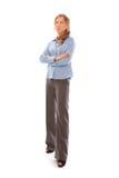 Junge Geschäftsfrau, die über weißem Hintergrund steht Lizenzfreies Stockfoto